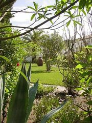 Casa da Figueira's tropical private yard, an ideal oasis to relax or play. - Praia da Luz Area villa vacation rental photo