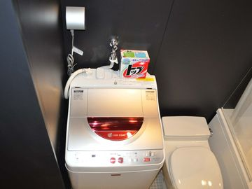 Each private room is equipped with an eco-friendly all-in-one washer/dryer.