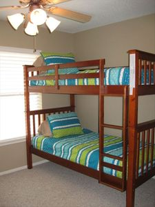 Bedroom 3 has 2 bunk bed sets to sleep 4.