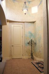 Paso Robles house photo - Entrance has custom plaster and mural, recieves warm lighting in the morning.