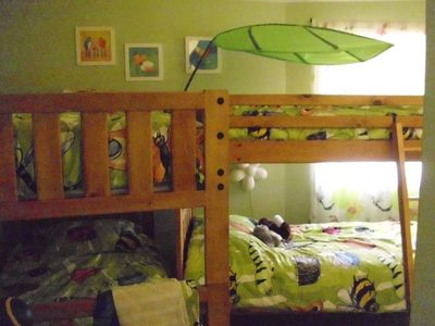 Kids bunk beds furnished with closet, toys and Mickey Mouse DVD player. (4 beds)