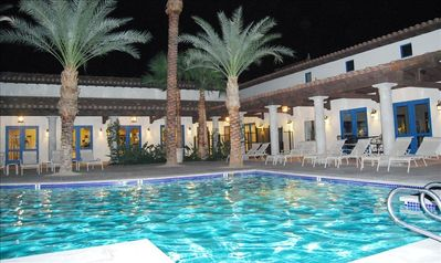 Clubhouse pool, shown at night with partial view of clubhouse in background!