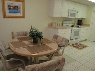 Cape Canaveral condo photo - Kitchen table and ovens