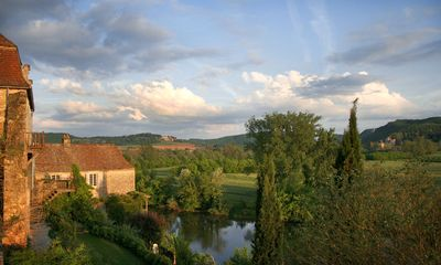 View from second floor balcony at sunset towards the chateau Marqueyssac.