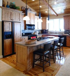 Entertainment kitchen: TWO gas cooktops, casual seating, all ammenities.