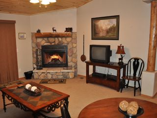 Show Low cabin photo - wood burning river-rock fireplace