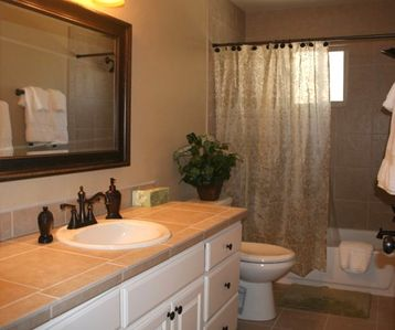 Beautifully appointed front bathroom and plush towels.