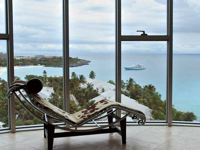 spectacular view of Mullet Bay from the bedroom with floor to ceiling windows