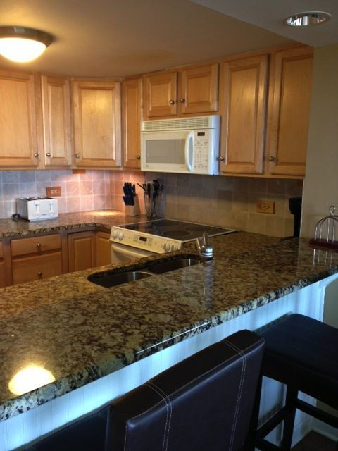 Beautiful granite kitchen with new cabinetry