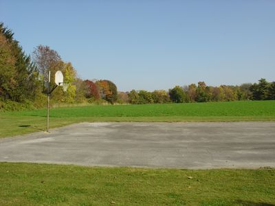 View of court and farm field from side yard