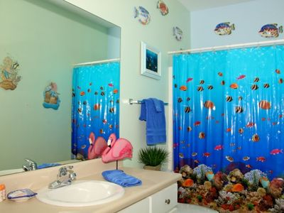 Downstairs full bath; bright and colorful; let's you know you are at the beach!