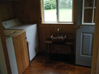 Paneled mud room with washer and dryer