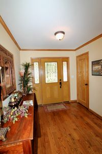 Inviting entry with wood floors.