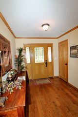 Hot Springs Village house photo - Inviting entry with wood floors.