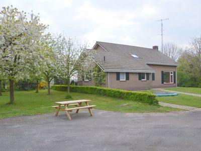 House with large enclosed garden and covered leisure areas with pinball machine and pool table