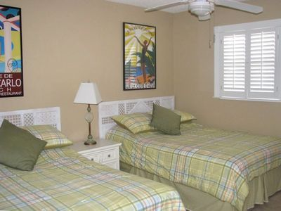 Guest Bedroom with 2 double beds and new shutters.