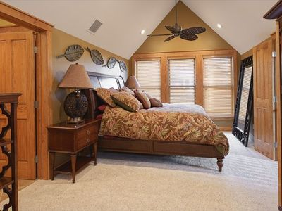 Master bedroom suite with king size bed and private bath