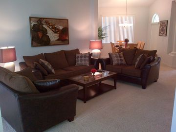 Living Room featuring Ultra Comfortable Modern Furnishings!