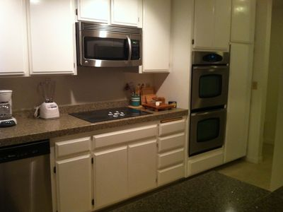 ...Double ovens, glass cooktop, microwave, dishwasher, side by side fridge
