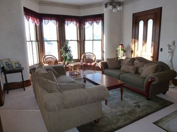 Main living room with large bay window offers great lake and mountain views.