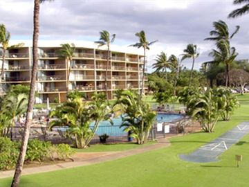 View beautiful grounds, pool and shuffle board from Lanai