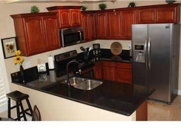 Beautifully appointed kitchen with cherry, granite and stainless features