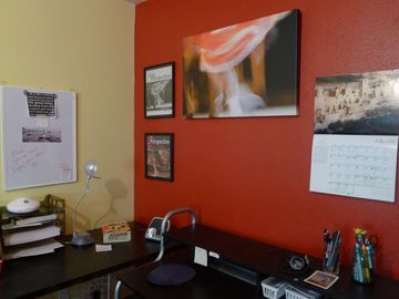 Great office space with lots of color and artwork to help make work enjoyable !