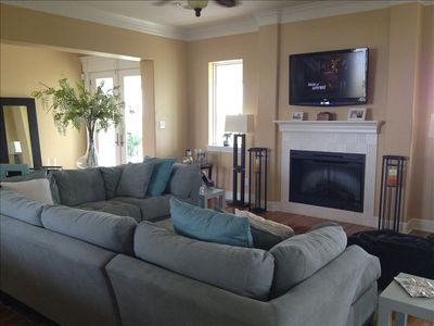 Spacious living room with fireplace, flat screen TV and surround sound stereo