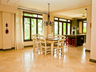 Dining area with kitchen. The stone tile floors keep your bare feet cool.
