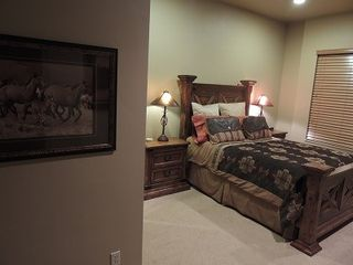 Eden house photo - Huge, comfortable, queen bedroom off front foyer with large, granite bathroom.