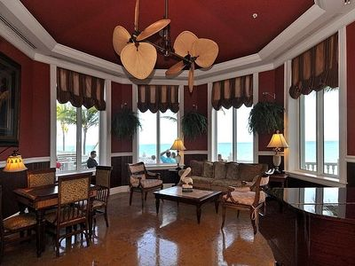 Sitting area in the lobby with a Grand Piano and GRANDER views of the ocean!