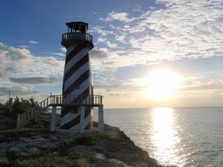 Grand Bahama Island cottage photo - High Rock Lighthouse at sunrise (walking distance)