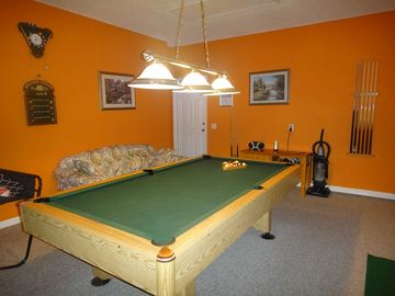 Game room with brandnew pool cue sticks from 18-21 oz and Billiard Scoreboard.