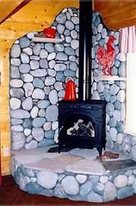 Gas Log Fireplace with River Rock Surround