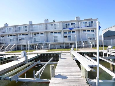 beautiful, upscale 3 bedroom townhouse with free wiFi, hBO channels, a boat lift, and impeccable style located right in the bay downtown and just three blocks to the beach!