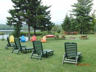 Adirondack chairs, picnic tables, firepit, hot tub - Colton cottage vacation rental photo