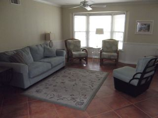 Jekyll Island house photo - Living room showing bay window facing back patio.