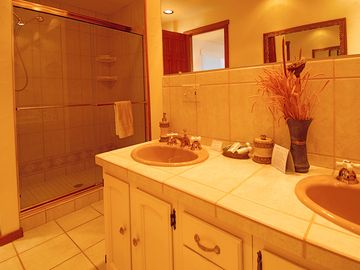 Master bath features dual vanities and large shower.
