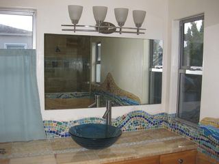 Ocean Beach house photo - Master bath with custom tile and counters.