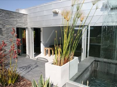 Glass doors slide completely open to a private patio
