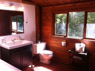 Bathroom with a forest view