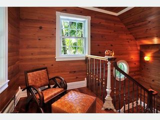 Key West house photo - Upstairs is a charming hallway sitting area with more Dade County Pine.