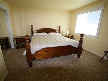 One of our King bedrooms, they are all beautiful! WETLAND VIEW