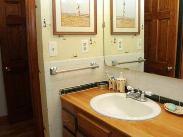 First floor bathroom with wood vanity and fantastic shower.