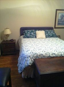 queen bed in the master bedroom