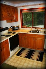 Indian River house photo - Full kitchen furnished with pots,