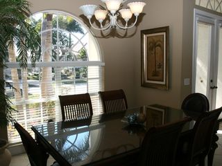 Vacation Homes in Marco Island house photo - Formal dining Tommy Bahama style. Great restaurants nearby.
