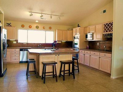Spacious, Renovated and Fully Equipped Kitchen with Center Island.