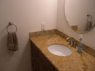 Warm Beach house photo - Main Bathroom Sink, Granite Counters, & Mirror
