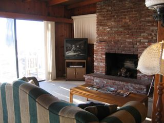 Newport Beach house photo - Enjoy the warm fireplace with an ocean view